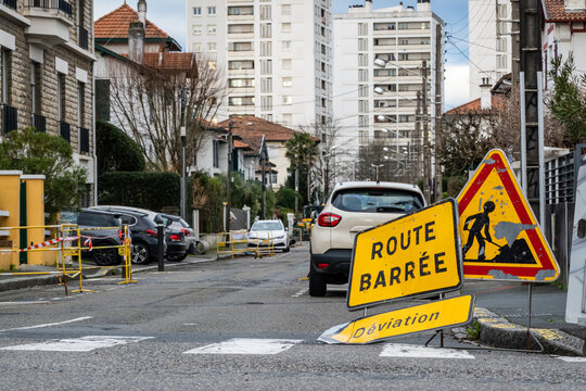 Road closed, diversion and road work signs in French town