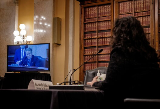 Isabella Casillas Guzman, right, listens as Sen. Rand Paul (R-KY) makes remarks during her Senate Small Business and Entrepreneurship hearings to consider her nomination to be Administrator of the Small Business Administration, in Washington