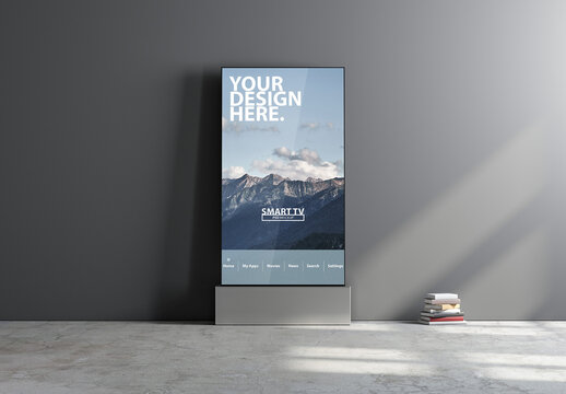 Vertical Smart TV Mockup Standing Near Gray Wall
