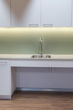 Modern kitchen interior sink with shallow depth for wheelchair access.