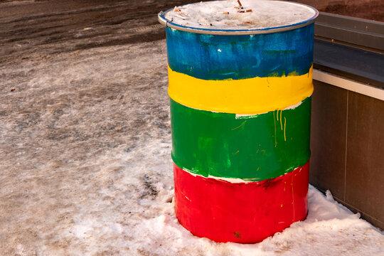 Creative multi-colored barrel ashtray near the bar, rainbow colored barrel, lgbt colors