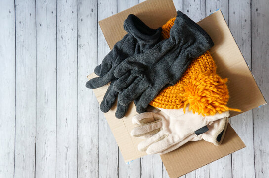 donations to the needy, warm clothes in a cardboard box