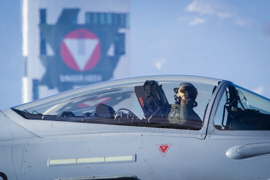 Austrian Air Force Eurofighter pilot with tower in background