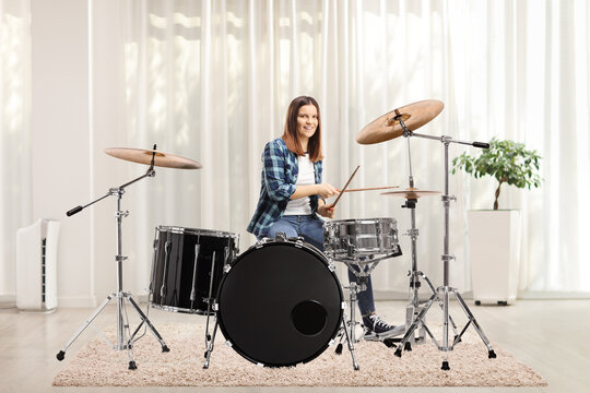 Female playing drums at home