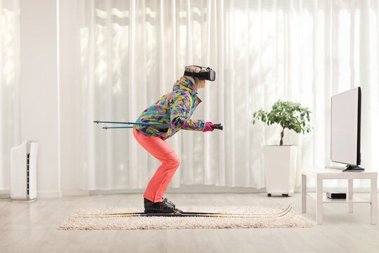 Female with a vr headset skiing at home