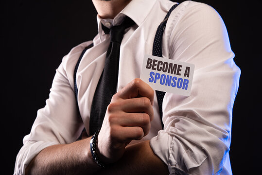 Become a Sponsor. Investment, Business Concept. Businessman holding a card with a message text written on it