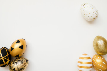 Easter golden decorated eggs isolated on white background. Minimal easter concept. Happy Easter card with copy space for text. Top view, flatlay