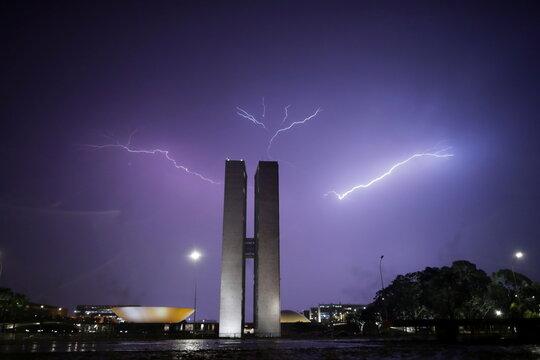 Lightning illuminates the sky above the National Congress in Brasilia, Brazil