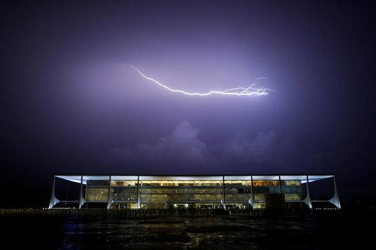 Lightning illuminates the sky above the Planalto Palace in Brasilia, Brazil