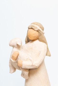 shepherd holding sheep; Christmas pageant scene