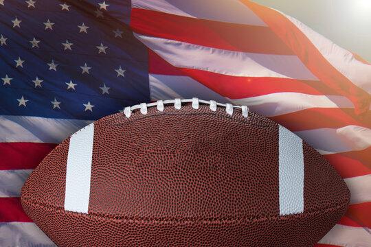 American football ball. Sport game. On background USA flag.