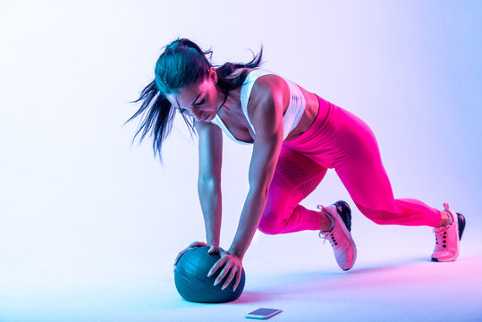 Woman training with the exercizes ball in the gym
