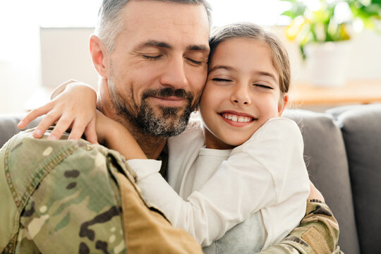 Happy military father and his daughter reunion