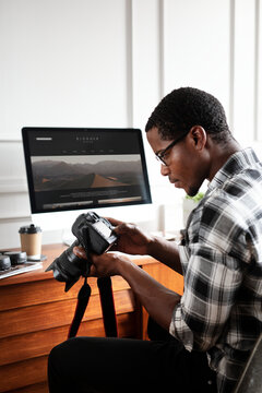 African American photographer working on his desk