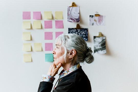 Senior businesswoman brainstorming