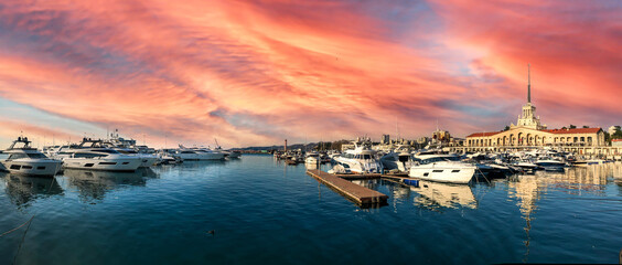 Panorama shot of the harbor in Sochi, Russia under the cloudy sky in pink shades
