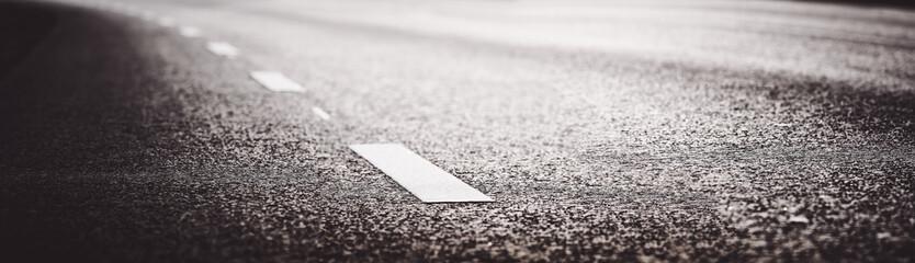 Black asphalt road and white dividing lines Fotobehang
