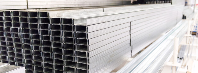 Obraz Metal profiles for drywall in a store. Selective focus. - fototapety do salonu