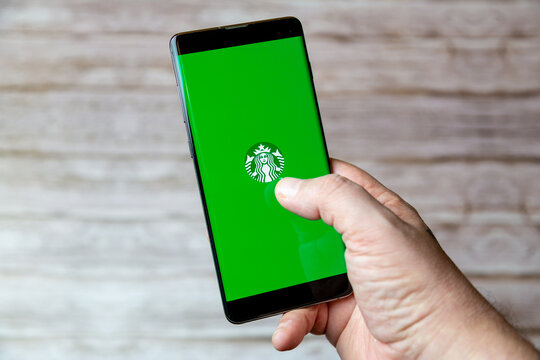02-04-2021 Portsmouth, Hampshire, UK A hand holding a Mobile phone or cell phone with the Starbucks coffee app on screen