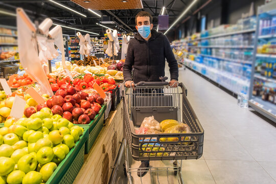 A man buys groceries at the supermarket. Selective focus.