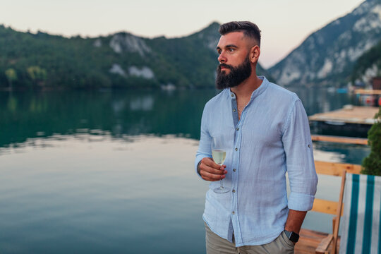 Male is drinking wine surrounded by beautiful nature
