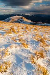 The golden hour in the mountain pastures in the Bieszczady Mountains after the first snowfall / Sunset in the mountain pastures in the Bieszczady Mountains