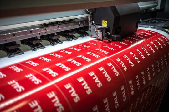 Full-color printing on the machine of the sticker with the inscription sale