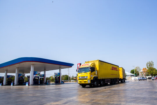 Bangkok, Thailand - February 7, 2021 : DHL truck in gas station. Truck for transportation and logistic.