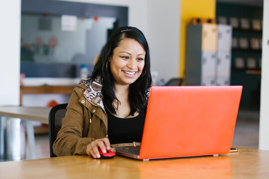 latin business woman working with computer at the office in Mexico city