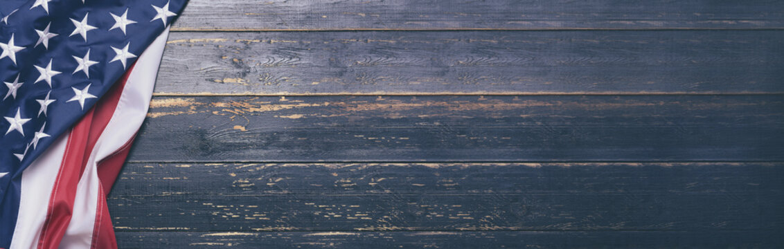 USA flag on wooden background with space for text