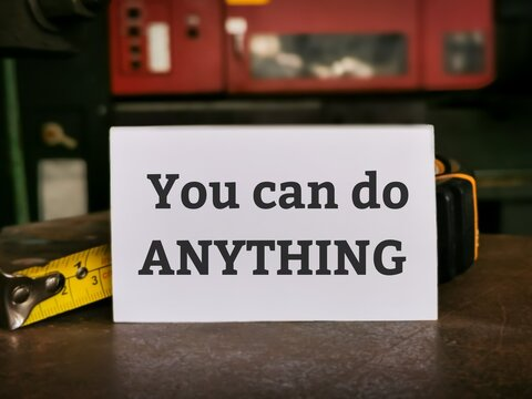 Phrase You can do ANYTHING written on white card. Motivational quote.