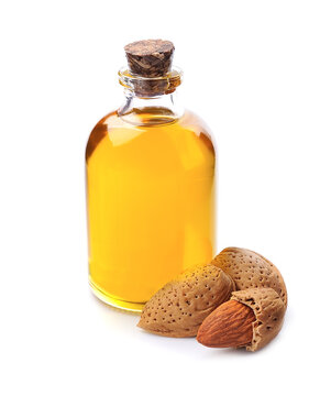 Almonds oil with almonds nuts on white backrounds.