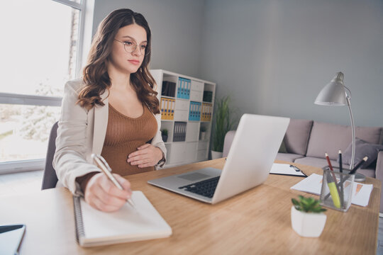 Photo of pregnant manager look netbook screen write diary wear suit brown shirt workstation office indoors