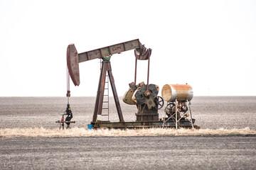 Oil Well On Land Against Clear Sky - fototapety na wymiar