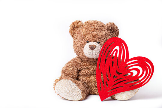 teddy bear holding heart isolated on white background