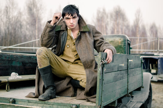Soviet soldier sitting on a military truck