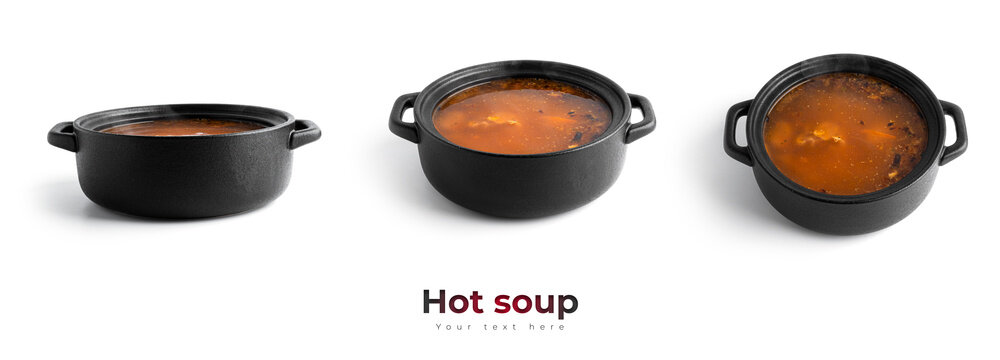 Hot soup in a black pot isolated on a white background.