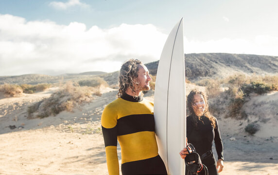 Two friends going to surf in the sea