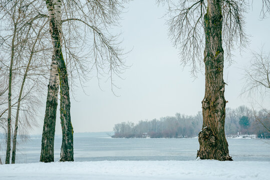 Landscape with frozen water, ice and snow on the Dnieper river in Kiev, Ukraine, during winter
