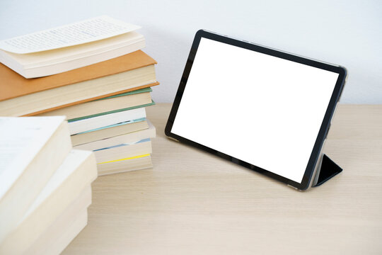 Tablet mockup and white screen on a table
