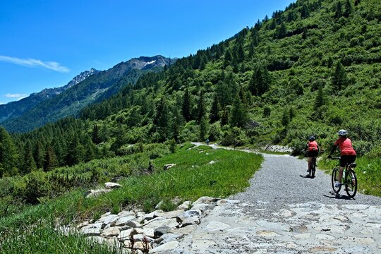 Italy-view on cyclists on the path from Passo del Tonale