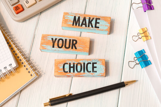 Make your choice - words written on wooden blocks