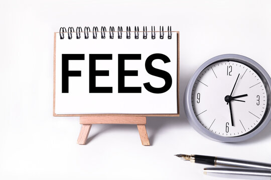 FEES, TEXT on white paper on a stand on a white background