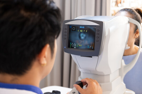Selective focus at screen of Optometry equipment. While optometrist using subjective refraction to  examine eye visual system of elder patient women with professional machine before made glasses.