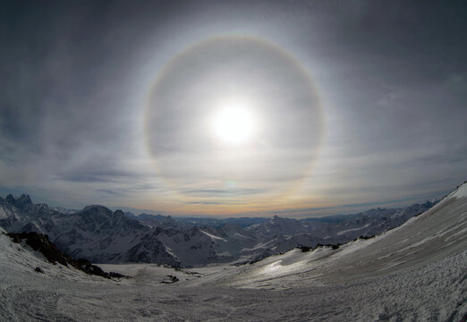 Solar halo and sunset over the Elbrus mountains.