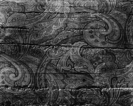 Vintage black and white paisley pattern on textured background
