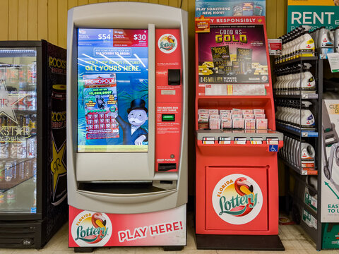 NORTH PORT FLORIDA - FEBRUARY 5, 2021 : Florida Lottery ticket vending machine. Lotto players choose from a selection of instant scratch off tickets or select numbers for chance to win millions.