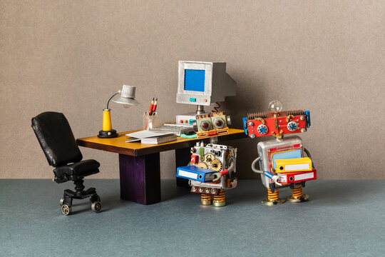 A funny robotics office managers holds a folders with documents. Retro office, black leather chair computer desk lamp old table. The concept of workflow business automation