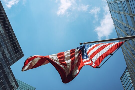 Low Angle View Of American Flag Hanging Against Sky