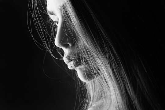 Sensual woman in shadow. Love teenager girl romance. Dreams and missing love.